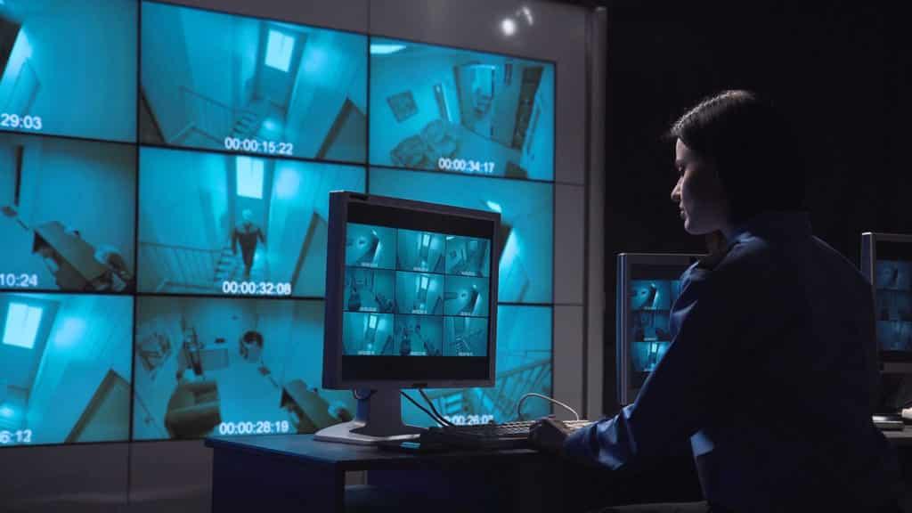 woman looking at surveillance display